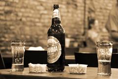 Cevecita con maní (Ce Rey) Tags: beer cerveza birra bar indoor highiso sepia bebida drink