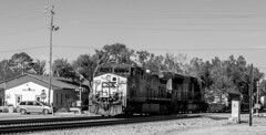 CSX 67 Southbound at the Folkston Funnel (Jim Frazier) Tags: 201801floridatrip 2019 67 bw ambientlight apparatus blackandwhite city cityscape csx desaturated devices doneexportedtoflickr engines equipment folkston freight funnel gkids ga georgia heavy heavymetal iron january jimfraziercom landscape lightroom locomotives machinery machines mechanical metal monochrome q3 railfan railfanning railroads railways roadtrip scenery scenic smalltown steel sunny town trains trainwatching transportation urban vacation winter f10 instagram