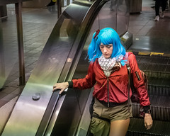 Escalating (John St John Photography) Tags: streetphotography candidphotography grandcentralterminal subwaystation 42ndstreet newyorkcity newyork woman youngwoman escalator blue hair peopleofnewyork colorphotography johnstjohnphotography