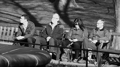 Enjoying the Spring Sunshine 02 (byronv2) Tags: scotland edinburgh edimbourg blackandwhite blackwhite bw monochrome bench banc seat seated sitting sunshine sunlight spring princesstreet princesstreetgardens gardens park newtown peoplewatching candid street people sit