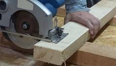The carpenter cutting the wood a hand circular saw (SawAdvisor) Tags: circular saw woodworking carpenter cutting circularsaw