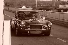 Aston Martin DB4 1961, HRDC Track Day, Goodwood Motor Circuit (3) (f1jherbert) Tags: sonya68 sonyalpha68 alpha68 sony alpha 68 a68 sonyilca68 sony68 sonyilca ilca68 ilca sonyslt68 sonyslt slt68 slt sonyalpha68ilca sonyilcaa68 goodwoodwestsussex goodwoodmotorcircuit westsussex goodwoodwestsussexengland hrdctrackdaygoodwoodmotorcircuit historicalracingdriversclubtrackdaygoodwoodmotorcircuit historicalracingdriversclubgoodwood historicalracingdriversclub hrdctrackday hrdcgoodwood hrdcgoodwoodmotorcircuit hrdc historical racing drivers club goodwood motor circuit west sussex brown white sepia bw brownandwhite