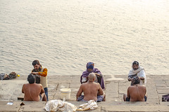 Shaving for the dead! (.stuart hamilton) Tags: india body death cremation asia ceremony haircut shave shaven barber bank river ganges varanasi men topless paving sit three six robes hair hairdresser blade razor