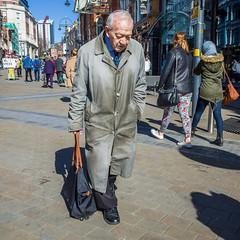 Leeds 045 (Peter.Bartlett) Tags: ricohgr unitedkingdom people city urbanarte westyorkshire colour lunaphoto man urban candid uk square yorkshire walking sign peterbartlett bag streetphotography leeds england gb