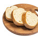 Sliced domestic homemade bread on the round wooden board