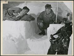 Two Lovat Scouts from Scotland ready to sleep in a snow house they built in Jasper, Alberta... / Deux membres du régiment écossais Lovat Scouts s'apprêtant à dormir dans un abri de neige qu'ils ont construit à Jasper (Alberta)... (BiblioArchives / LibraryArchives) Tags: lac bac libraryandarchivescanada bibliothèqueetarchivescanada canada sleep beds bed men homme soldiers soldats lovatscouts jasper alberta harryrowed 1944 nationalfilmboardofcanada officenationaldufilmducanada lit lits endormi endormie
