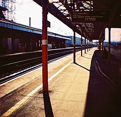 Railway Platform, Penrith, February 2016 (Mano Green) Tags: railway train platorm station sun shadow cross process lake district penrith england uk winter february 2016 diana mini agfa precisa colour slide 100 35mm film