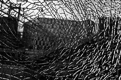 Broken Window Pane_DSC2460 (jonwaz) Tags: glass blanco y negro black white bw blackandwhite monochrome lund sweden jonwaz sony dscrx100m3 window broken abstract station