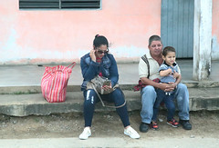 Family Matters (peterkelly) Tags: digital canon 6d northamerica cuba cubalibre gadventures pinardelrio state sitting family boy man woman smartphone cellphone waiting bag purse