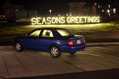 Seasons Greetings (Curtis Gregory Perry) Tags: seabrook washington seasons greeting light sign night longexposure blue car sedan mazda protege nikon d810 automóvil coche carro vehículo مركبة veículo fahrzeug automobil
