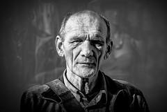 faced by a stranger (Gerrit-Jan Visser) Tags: bewerkt streetportrait bnw blackandwhite man wrinkles face character harch stranger facing