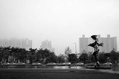 Going in the left direction (cam-pics) Tags: south korea busan cinema center street cars statue black bw white fog skyscrapers nikon d5100