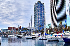 Al Port Olimpic (Fnikos) Tags: sea seascape water waterfront mar sky skyline cloud boat sailboat ship building tower architecture tree palmtree nature construction fish peix vehicle light reflection outdoor