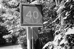 Speed sign says 40 (Matthew Paul Argall) Tags: canonsnappy20 fixedfocus 35mmfilm kentmere100 100isofilm blackandwhite blackandwhitefilm sign speedsign