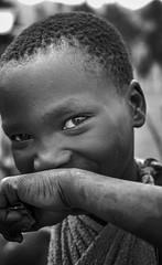 Suri Girl (Rod Waddington) Tags: africa african afrique afrika äthiopien ethiopia ethiopian ethnic ethnicity etiopia ethiopie etiopian outdoor omovalley omo omoriver minority girl culture cultural child candid streetphotography street town blackandwhite monochrome mono suri tribe traditional tribal