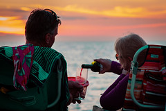 Wine at Sunset (isabellamcd99) Tags: honeymoon wife husband relationship wine sunset beach red sun ocean chairs sunglasses sky landscape couple love