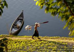 Fisherman On Irrawaddy River Banks, Myanmar (Eric Lafforgue) Tags: asia myanmar burma tourism pagan bagan river bank boat traditionallymyanmarian transportation ruralscene outdoors riverbank horizontal colourpicture traveldestinations oneperson asian unrecognizableperson fulllength burma8545
