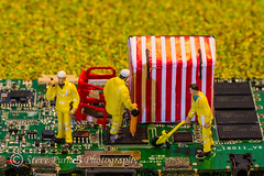 Short Circuited (Steve Purnell Photography) Tags: roadsidetechnicians engineers littlepeople circuitboard workers men field electricity roadsystem tent barriers grass maleworkers overalls uniforms tools emergencyrepairs repairs