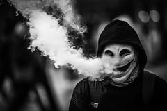smoking kills all alliens (Gerrit-Jan Visser) Tags: bewerkt streetphotography amsterdam damsquare blackandwhite smoke smoking alien kills mask