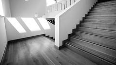 wood, stone, and light (pix-4-2-day) Tags: stairs treppe stufen steps white blackandwhite monochrome monochrom schwarzweis treppenhaus sonnenlicht licht light wood holz zickzack zigzag leuchten lamps architecture staircase