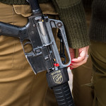 Israeli soldier woman with her gun. thumbnail
