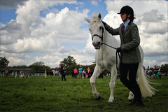 Here, There's a Camera Pointed at Me (meniscuslens) Tags: pony horse lady woman girl hat sky clouds grass paddock arena event bucks county show buckinghamshire aylesbury weedon