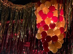 View from the Bar (Cathy de Moll) Tags: bar decoration gaudy lights hanging grapes orange red surreal iphone abstract glitter
