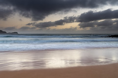 Low Clouds and Sunrise at the Seaside (Merrillie) Tags: daybreak sunrise nature dawn rocky centralcoast morning weather newsouthwales rocks earlymorning nsw sea australia ocean avocabeach landscape sky coastal waterscape outdoors seascape clouds coast water waves