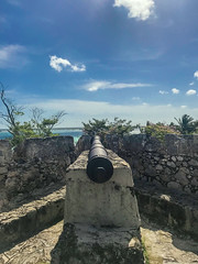 canon of the bacalar fort (ikarusmedia) Tags: blue sky clouds lagoon canon ruins ancient old colonial bacalar quintana roo mexico palms trees fort