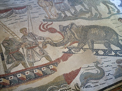 Romans load an elephant onto a galleon (peter.a.klein (Boulanger-Croissant)) Tags: sicily italy villacasale roman ancient archaelogy villa 4thcentury mosaics art hunting expedition africa men elephant dolphin galleon ship