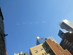 # IWD Look Up - Skywriting over Hell's Kitchen 3384 (Brechtbug) Tags: iwd look up international womens day blaze a trail jet planes sky writing vapor ads cloud advertising above clinton hells kitchen neighborhood near 9th avenue west 42nd street nyc 2019 new york city midtown manhattan 03092019 skywriting airplane ad ubiquitous social media team airplanes jets