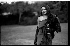 ArthurMichael10.21.18_024 (Johnny Martyr) Tags: woman she her glass wine drinking dress smile cheeks cheekbones shoulder bokeh gloves fur formal attire leica leitz summicron 90mm e55 preasph kodak tmax hc110 bw black white film rangefinder class classy classic lips eyes