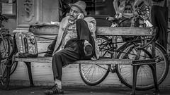 Man talking in his mobile at Stureplan in Stockholm Sweden 19/8 2013. (photoola) Tags: stockholm street mobil sv bänk bench photoola blackandwhite monochrome stureplan sweden