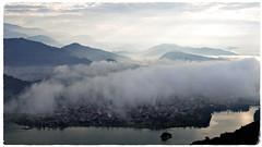 Nepal (Rolfmundi) Tags: nepal pokhara wolken see wasser gebäude berge