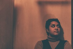 Waiting to see the new beginning... (subhojitchoudhury) Tags: canon77d canon candid calm 50mm prime primelens lowlight looks friend dark red casual experimental contrast face portrait shadow shade avantgarde