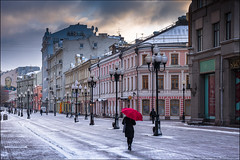 March weather in Moscow. (Yuri Degtyarev) Tags: march weather moscow snow spring red umbrella houses arbat clouds мартовская погода москва старый арбат снег облака красный зонт девушка girl улица