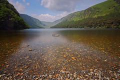 Glendalough Upper Lake (Colin Kavanagh) Tags: nature lake glendalough ireland cowicklow water reflection stones eire loveireland visitireland visitwicklow lovewicklow gardencounty outdoors mountains wicklow wicklowmountains trees valley glen rocks landscape landscapephotography irishphotography irish irishphoto irishlandscape hiking longexposure