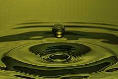 A drop of water on the way into the hole (CHWVB) Tags: water weeklythemechallenge holes macromondays wassertropfen splash waterdrop wasser tropfenfotografie macro highspeed drop tropfen yellow hochgeschwindigkeit