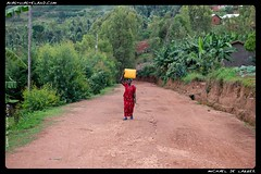 Weight. (mobyavid) Tags: worldvision africa african nikon d850 2470mm walking walk water carry woman mother mom culture huye rwanda remote