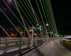 LOOKING AT PORTLAND THRU THE TILLIKUM BRIDGE CABLES (AvgeekJoe) Tags: bridgeofthepeople d5300 dslr nikon nikond5300 oregon portland tamron18400mm tamron18400mmf3563diiivchld tilikumcrossing tilikumcrossingbridgeofthepeople willametteriver bridge cablestayedbridge night nightphoto nightphotograph nightphotography nightshot transitbridge