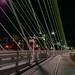 LOOKING AT PORTLAND THRU THE TILLIKUM BRIDGE CABLES