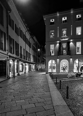 Sale! (mswan777) Tags: night monochrome white black mobile iphone iphoneography apple italy varese travel stone architecture urban outdoor window sign sale business store building walk street city