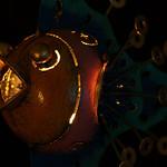 metallerner Fisch mit Fauerbauch schwimmend im Äther thumbnail