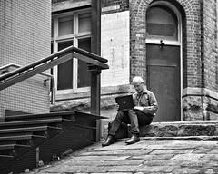 focus on being productive instead of busy (gro57074@bigpond.net.au) Tags: productive business focusonbeingproductiveinsteadofbusy f28 bw monochrome monotone mono blackwhite tamron 2470mmf28 d850 nikon ramp alleyway alley sydney cbd sandstone stairs businessman laptop man candidphotography candidstreet stphotographia streetphotography street 2019 february guyclift