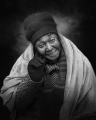 Yvonne (mckenziemedia) Tags: woman stockingcap hat coat blanket gloves smile portrait portraiture winter hand blackandwhite monochrome people humanity human chicago urban street city streetphotography homeless homelessness
