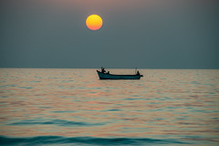 Three men in a boat... (gilliesavo. Catching up :)) Tags: sunsest coast reflections fishing three silhouette ripples sea india greys calm timeless beauty arabiansea movement tranquility
