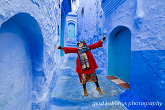 Girl in red in the blue town (Gerd Kohlmus) Tags: girl red chefchaouen blue town morocco portrait